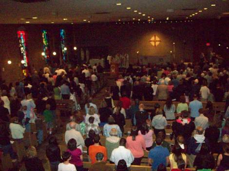 Students join in worship at the 7:00 p.m. mass on September 9, 2012.