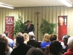 Image of George Weigel speaking to audience.